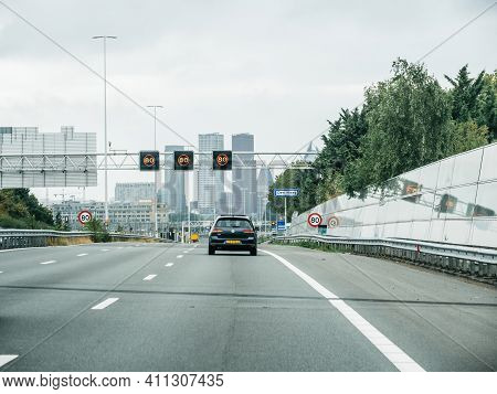 The Hague, Netherlands - Aug 19, 2018: One Lonely Car Approaching The Hague Capital With Tall Busine