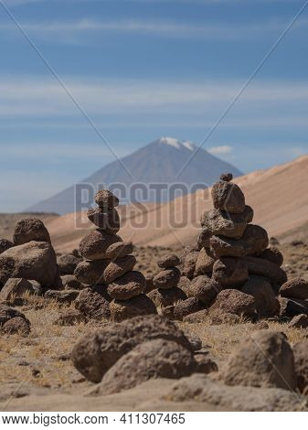 Stone Cairns Manmade Balancing Tower Stacked Rocks Along Road From Colca Canyon To Arequipa With Mis