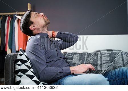 Business Man Overtime Work Massaging His Neck While Suffering From Pain, Uses A Neck Collar To Relie