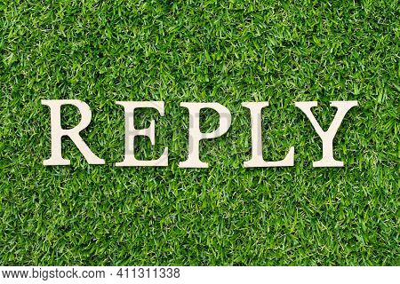 Wood Alphabet Letter In Word Reply On Green Grass Background