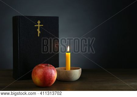 Bible, Candle And Apple On Wooden Table, Space For Text. Lent Season