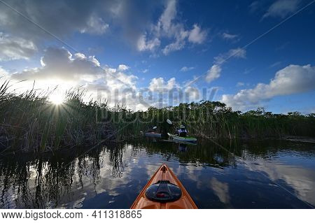 Woman And Active Senior Kayaking On Nine Mile Pond In Everglades National Park, Florida On Sunny Win