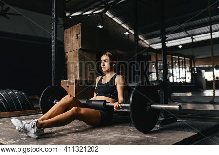 Fit Young Woman At A Crossfit Style On Dark Gray Background. Fitness, Functional, Training, And Life