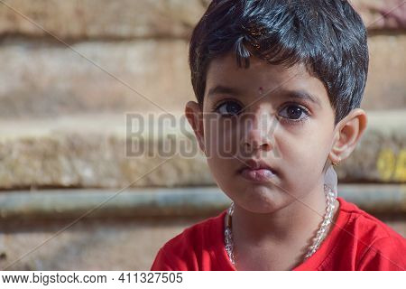 Stock Photo Of A 3 To 7 Years Old Cute Indian Little Girl Who Wearing Red Color T Shirt And Sitting