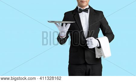 Handsome Waiter In Tuxedo And Gloves Holding Empty Tray And Napkin Whit Dicut Part