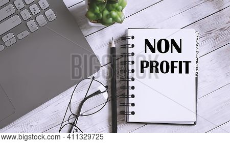 Non Profit Text On Notebook With Office Background