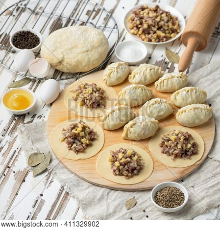 Homemade Food Preparation. Raw Meat Filling On Rolling Dough Circlesprocess Of Cooking Dumplings. To