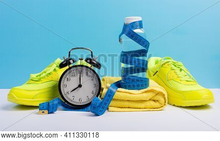 Running, Jogging And Yoga For Weight Loss Concept With Sneakers, Bottle Of Water, Towel, Timer And M
