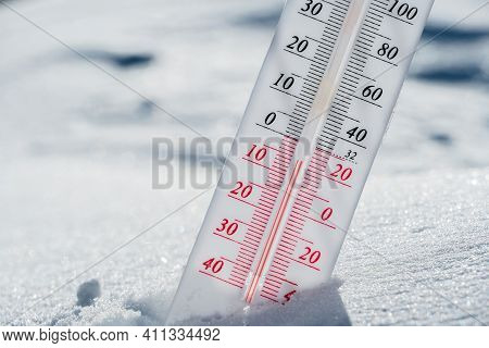 The Thermometer Lies On The Snow In Winter Showing A Negative Temperature.meteorological Conditions