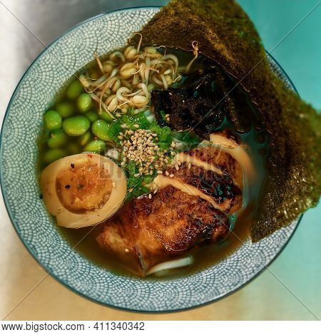 Soup With Chicken And Nori In A Deep Bowl. Healthy Soup Is On The Table In A Restaurant As An Order.