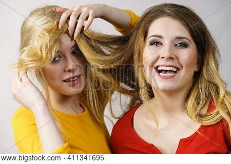 Two Girls Creating Hairdo. Hair Ombre Color