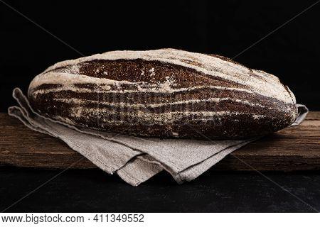 Freshly Baked Homemade Artisan Sourdough Rye Bread On Wooden Board. Closeup Of Farmhouse Bread At Le