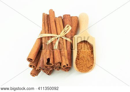 Cinnamon Sticks And Cinnamon Powder Isolated On White Background, Healthy Spice, (cinnamomum)
