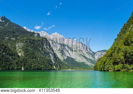 Lake Koenigssee With Rocks And Trees In The Berchtesgaden Alps, Germany.