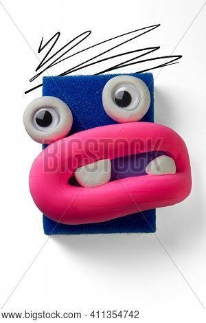 Animated blue sponge with big eyes and big lips by soft clay. Emotions things
