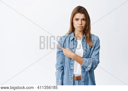 That Is Unfair. Displeased And Upset Young Woman Frowning Offended And Complaining, Pointing Finger