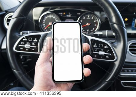 Male Hand Using Smartphone In Car. Man Driving A Car. Smartphone In A Car Use For Navigate Or Gps. M