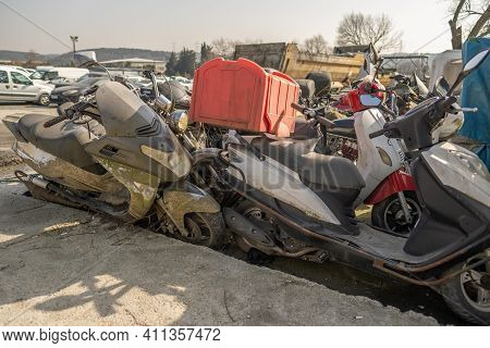 A Lot Of Motorcycle Salvage Scrap In Junkyard Outside The City In A Sunny Day