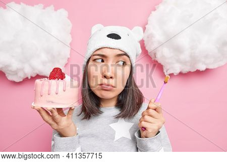 Upset Gloomy Asian Woman Looks Sadly At Toothbrush Has Problems With Teeth As Eats Too Much Sweets H
