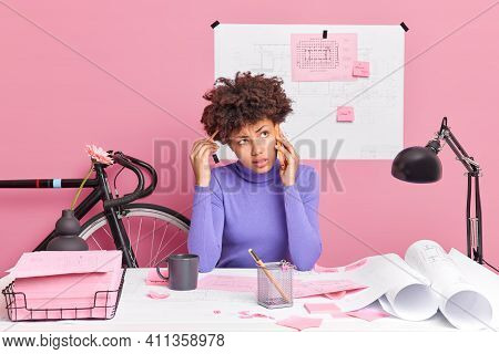 Problem Solving Concept. Puzzled Afro American Woman Has Telephone Conversation Tries To Decide How
