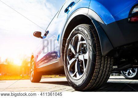 Blue Family Business Spotrs Hatchback Car On Sunset. Business Success Concept