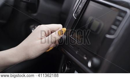 The Driver Adjusting The Volume Of A Radio Inside A Car. Action. Close Up Of A Woman Hand With Yello