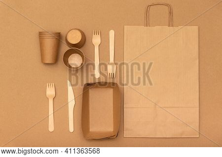 Eco Natural Paper Cups, Bag, Forks On Kraft Background With Copyspace, Flat Lay. Recycled Kraft Pape