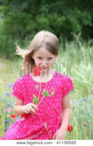 Little girl with poppy flowers