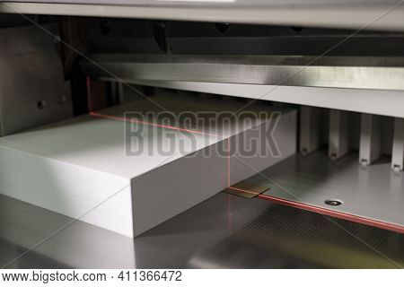 Modern Machine For Cutting Sheets Of Paper Close Up View
