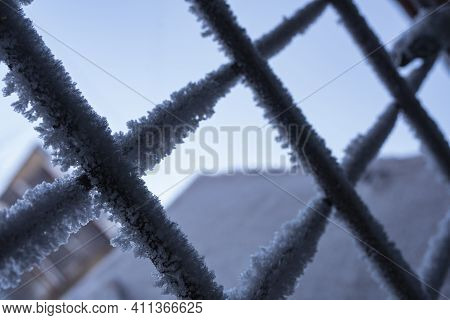 Metal Wire Door Are Covered With Frost - Freezes Icy With Snowflakes