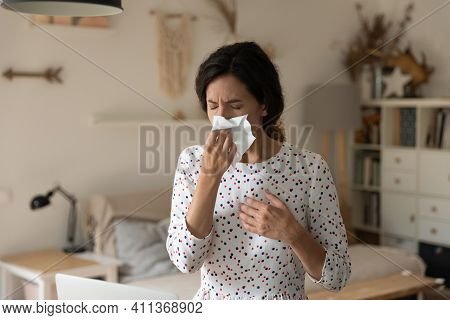 Unhealthy Female Sneeze Wipe Nose With Tissue Suffer Of Rhinitis