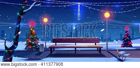 Christmas In Night City Park, Empty Public Garden With Decorated Fir-trees, Bench And Lighting Garla