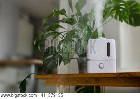 Air Humidifier During Operation. A White Humidifier Humidifies Dry Air. Improving The Comfort Of Liv