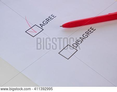 Agree And Disagree Check Boxes On The White Sheet Mark Agree With Red Pen. Selective Focus On The Ag