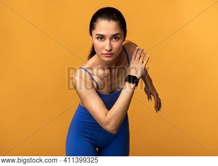 Cardio Workout And Competition Concept. Portrait Of Sporty Young Lady Running Towards Camera. Determ