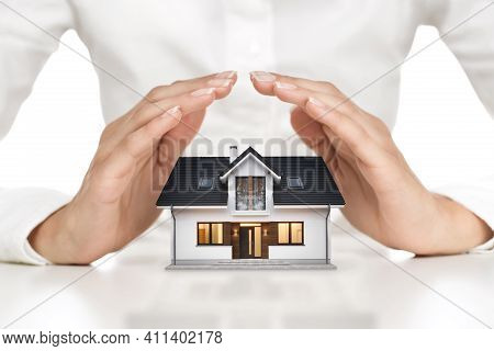 Home Protection Concept, Close Up Of Female Hands Covering Modern House