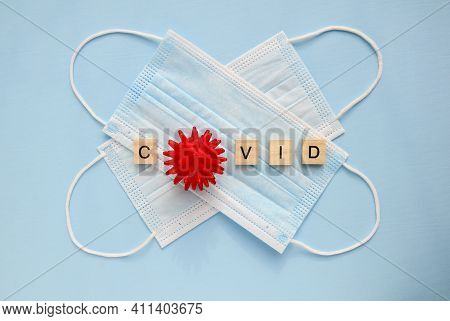 Two Medical Masks On A Blue Background. Inscription Covid. Cured Of Coronavirus, End Of Coronavirus,