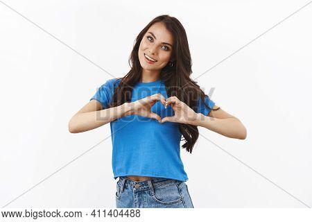 Tender, Feminine Brunette Female In Basian Blue T-shirt, Tilt Head Cute, Smiling And Showing Heart G