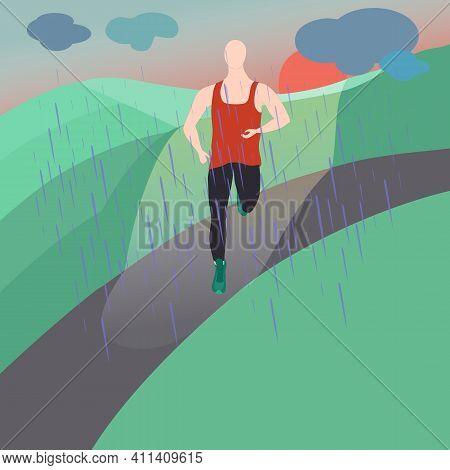 Single Man Jogging On The Road Under The Rain Among Green Fields. Evening Jogging With Rain And Suns