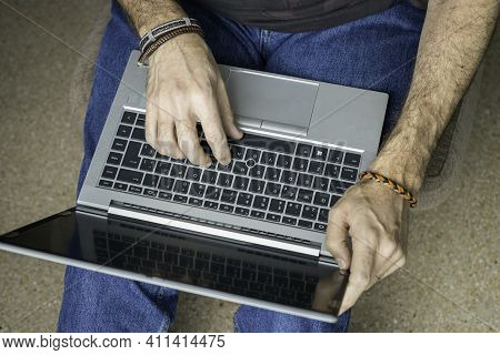 Man Working With Laptop From Home Conceptual Remote Work, Telecommuting, Technology