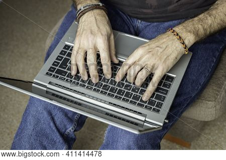 Man Working With Laptop From Home\nconceptual Remote Work, Telecommuting, Technology