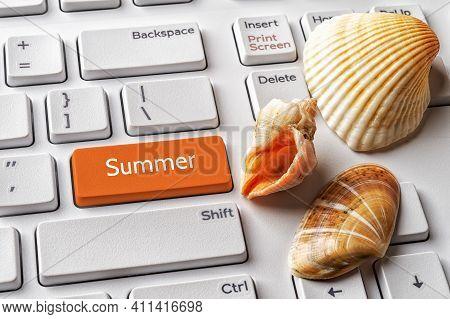 Orange Key With Summer Word And Three Seashells On A White Computer Keyboard. Summer Season Vacation