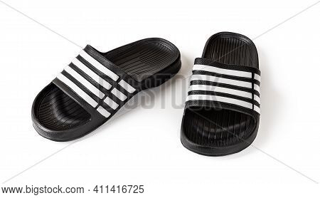 Pair Of Slide Sandals Isolated On White. Black Rubber Slippers Closeup. Light Shoes For Pool Or Show