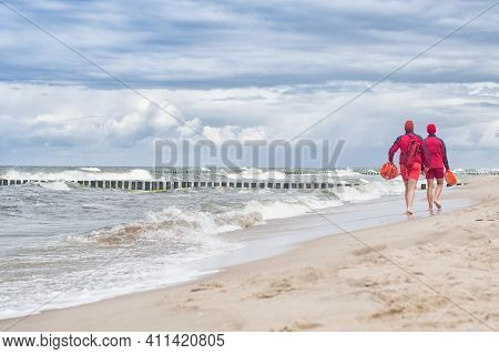 Lifeguards Go And Watching People In The Water. Poland