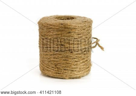 A Skein Of Linen String, Cord Isolated. A Skein Of Brown Wool For Knitting On A White Background.