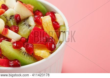 Fruit Salad In A White Cup On A Pink Background, Free Space For Text.