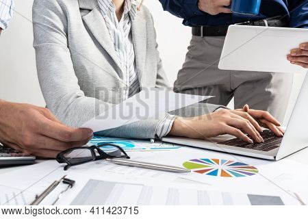 Corporate Teamwork Concept With Businessmen. Secretary Working With Laptop Office Desk With Financia