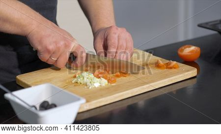 Close-up Of Chef Slicing Tomatoes. Art. Professional Chef Cuts Fresh Tomatoes With Sharp Knife. Chef