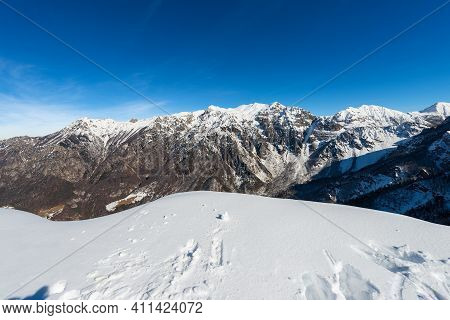 Snow Capped Mountains In Winter Of The Monte Carega, Called The Small Dolomites From The Altopiano D