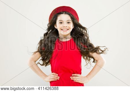 Volume Hair. Little Girl In French Style Hat. Happy Girl With Long Curly Hair In Beret. Childhood. H